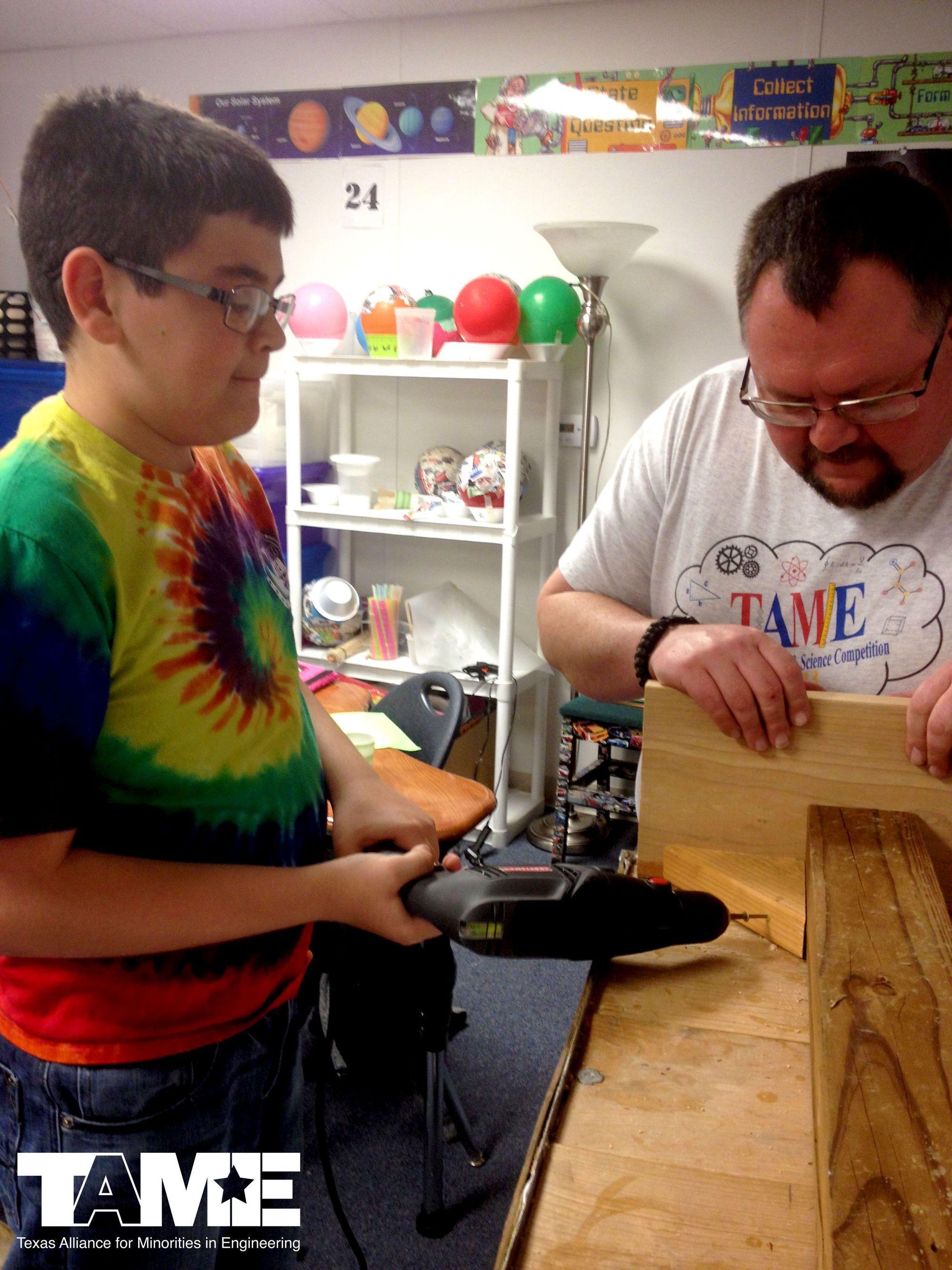 TAME Teacher and Alumnus Jeff Vann helps an Odessa student at UTPB Academy learn to use power tools