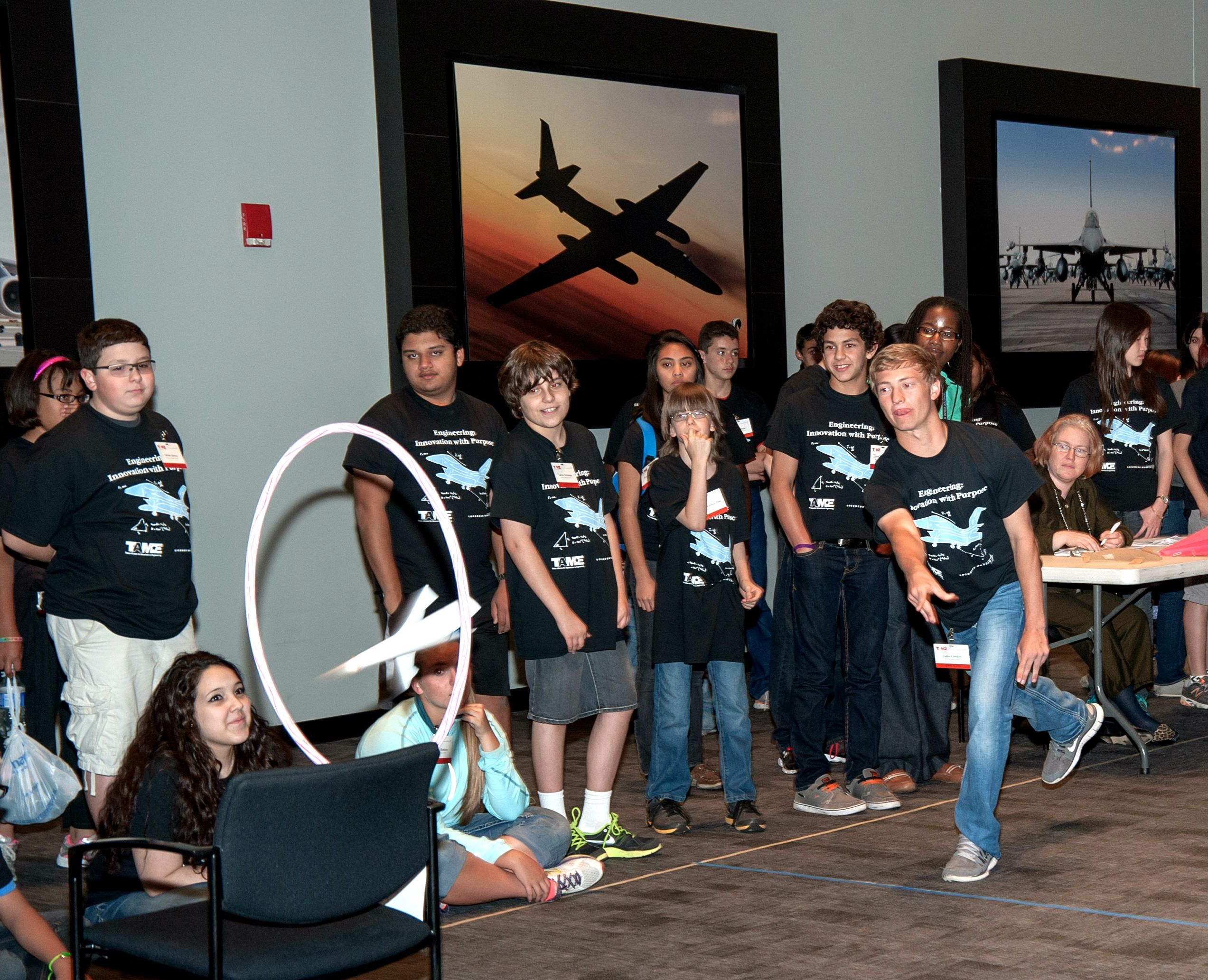 Students fly stunt planes in the Engineering Design Challenge at TAME's 2014 State Math and Science Competition.